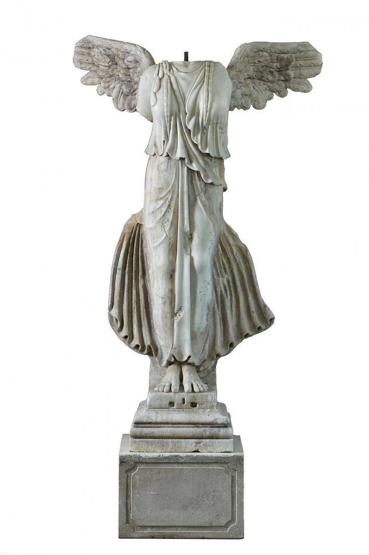 A sculpted marble figure of a winged female Victory, a