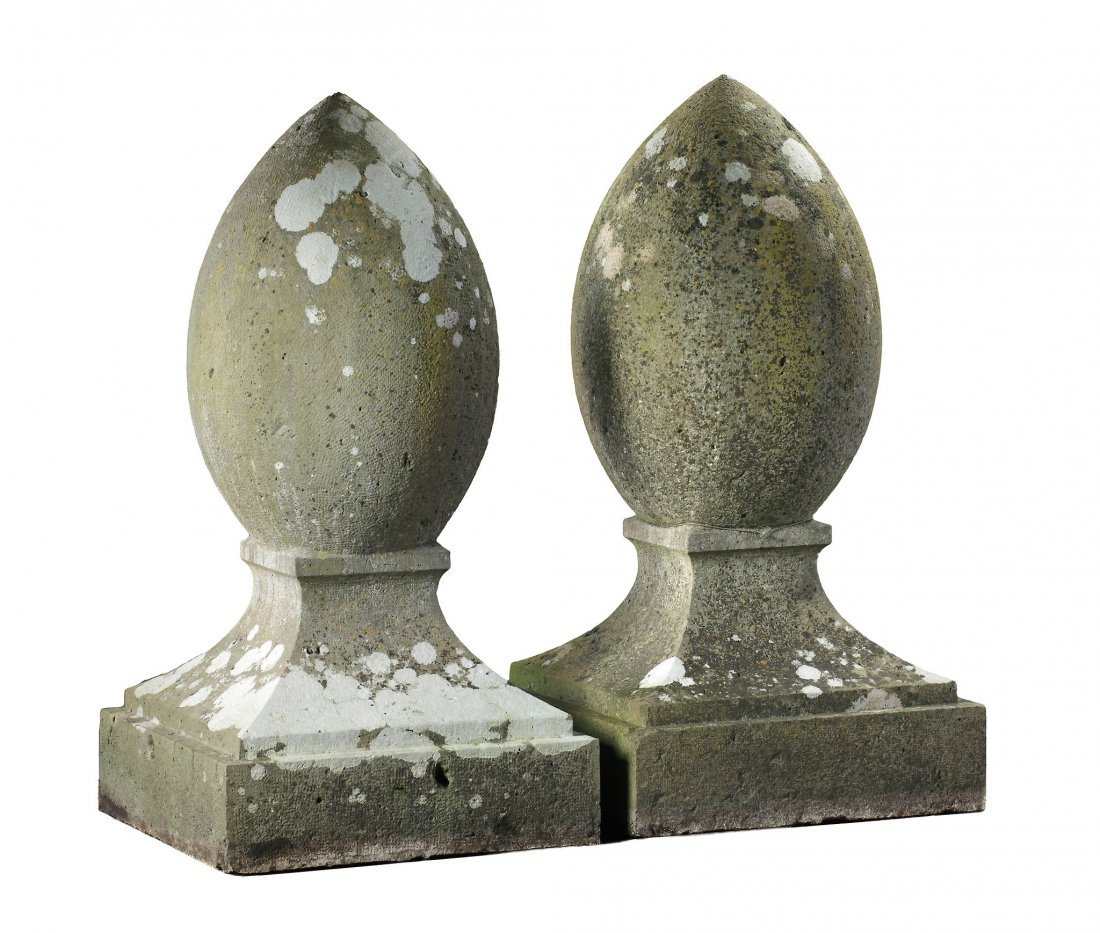 A pair of large carved Bourgogne stone stylised acorn