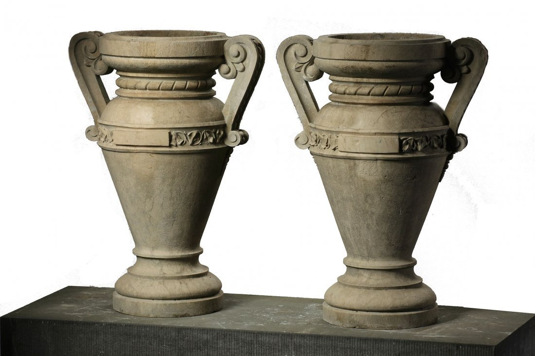 A pair of Italian carved Istrian stone urns, late 19th