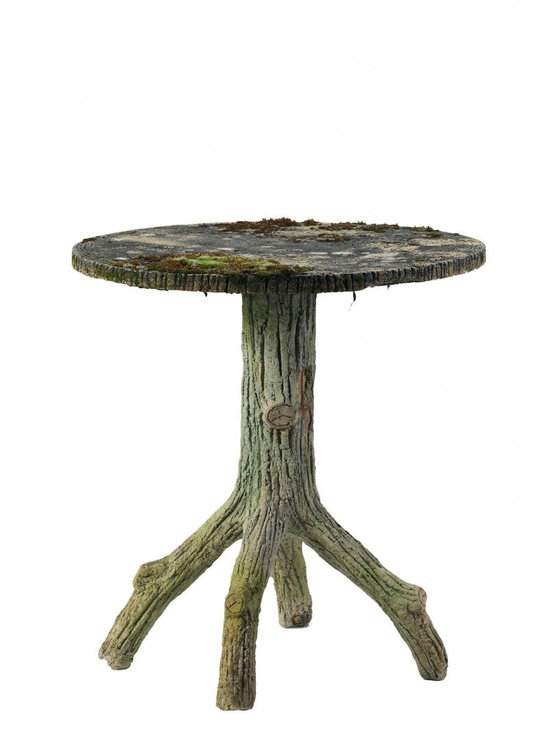 A stone composition faux bois garden table , late 19th