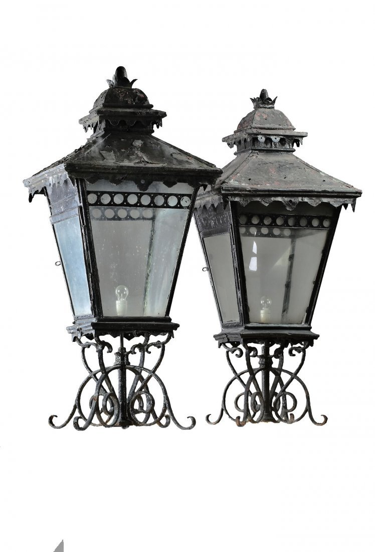A pair of large wrought iron and glazed pier lanterns