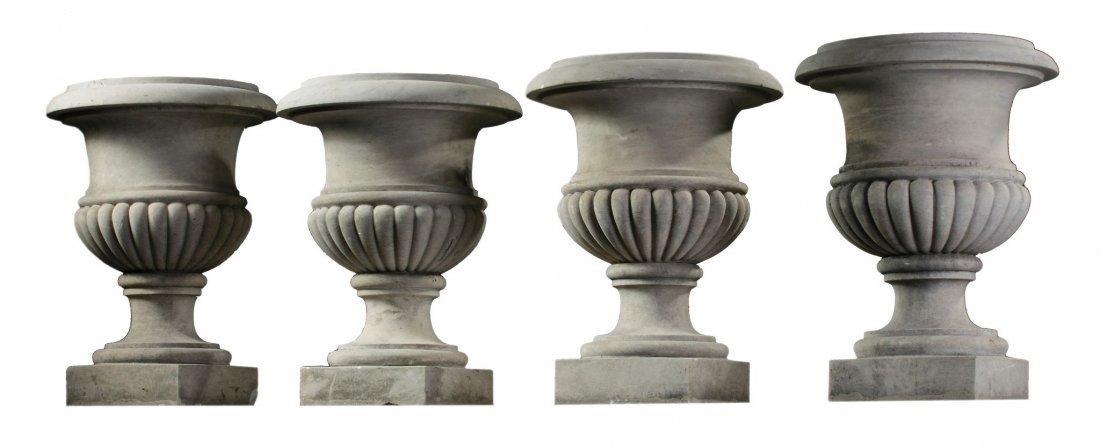 A set of four carved Carrara marble urns, 19th century,