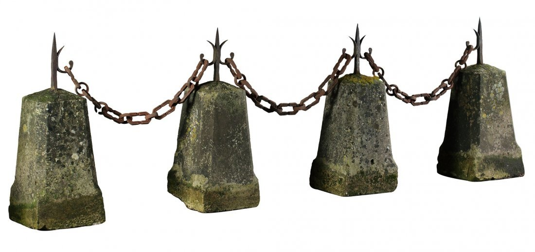 A set of four limestone and wrought iron mounted border