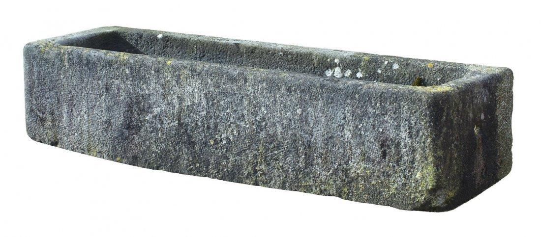A Continental rough hewn limestone trough, 18th/ 19th