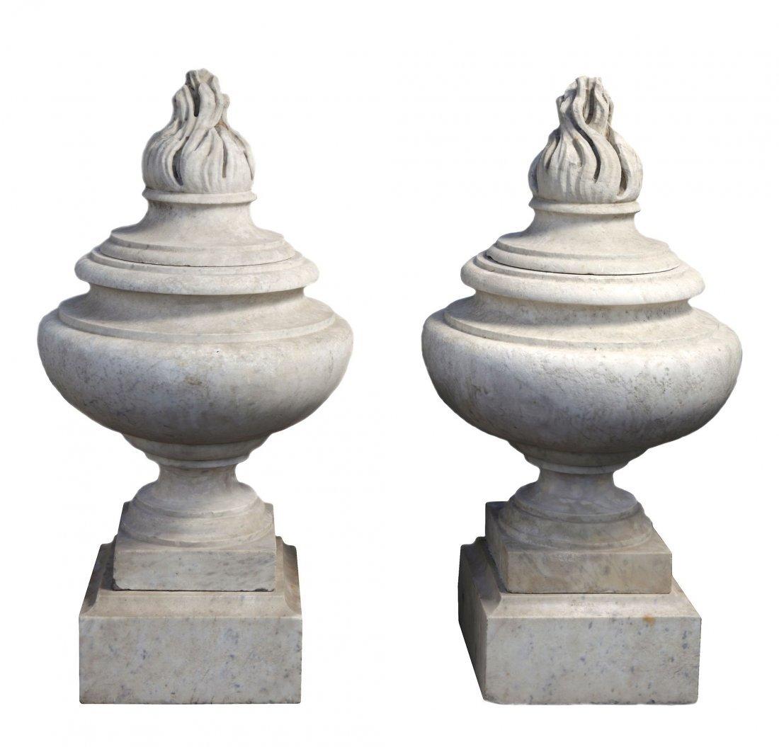 A pair of carved Carrara marble flambeau urn finials,