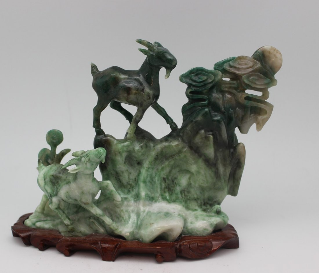 JADE CARVED SCULPTURE WITH WOOD BASE