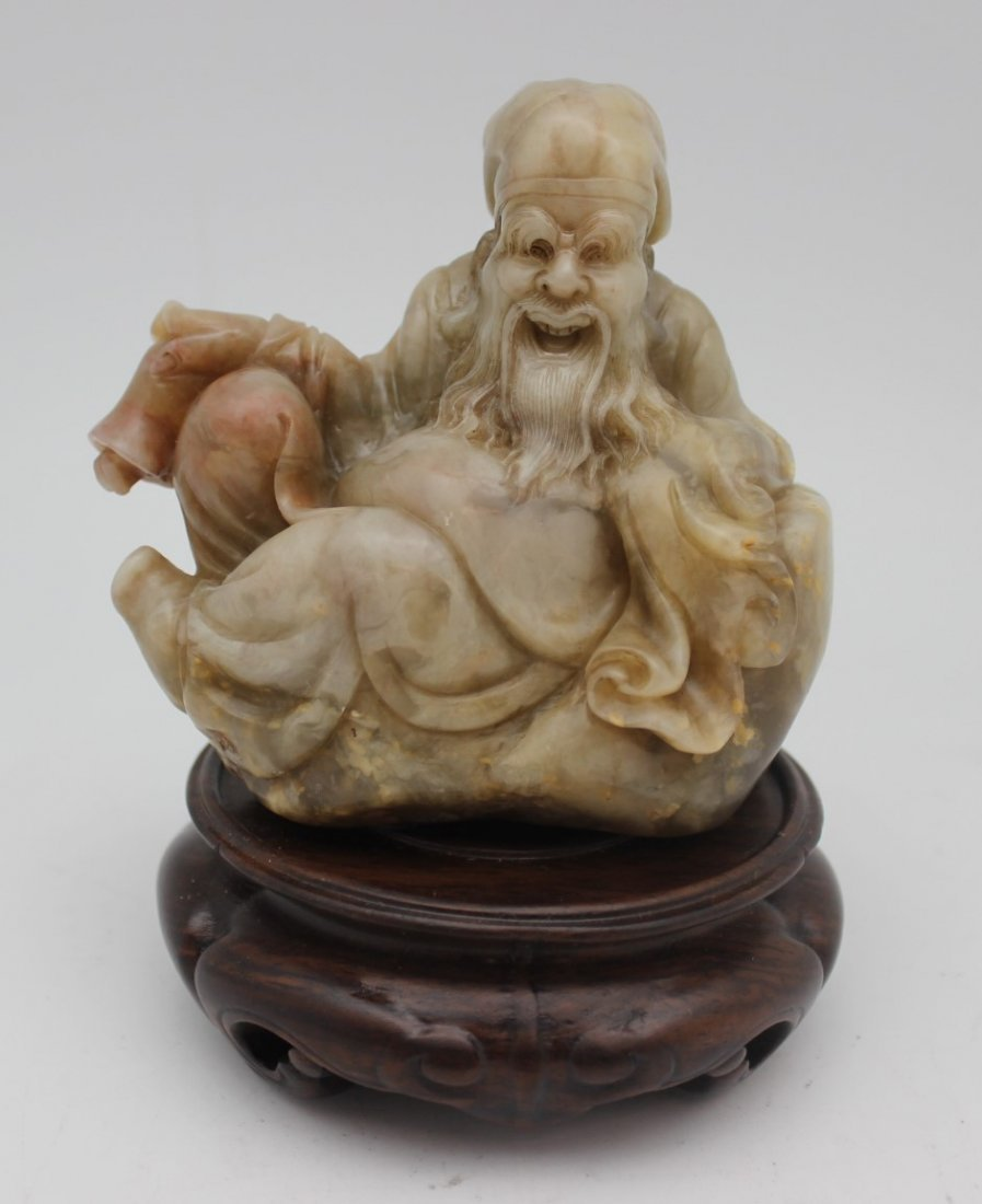 SOAPSTONE SCULPTURE WITH WOOD BASE