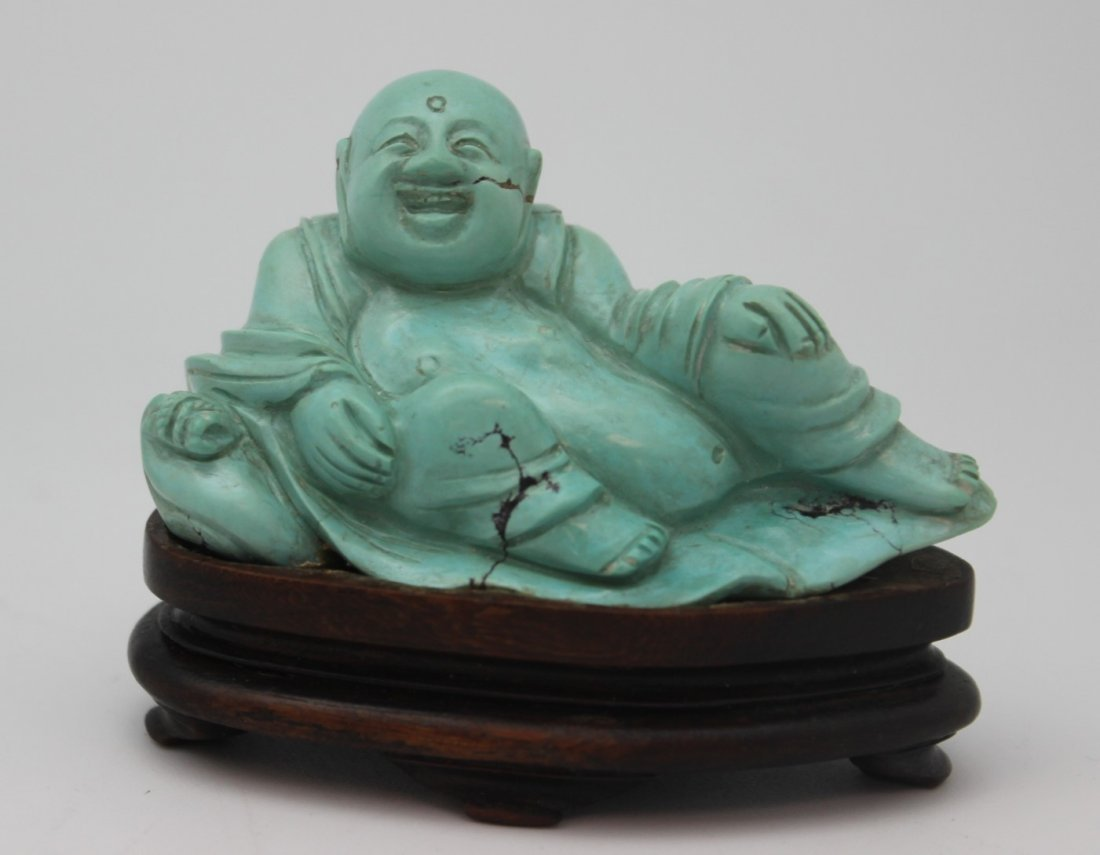 TURQUOISE CARVED SCULPTURE WITH WOOD BASE