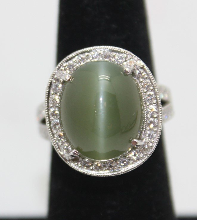18 K DIAMOND CAT'S EYES RING WITH GIA CERTIFICATE