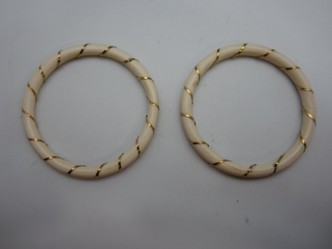 PAIR OF IVORY BANGLES WITH 14 K GOLD WIRE