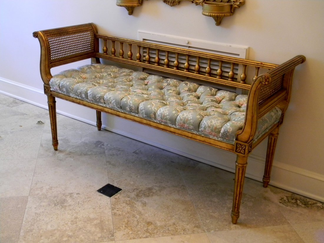 Tufted gold leaf Louis XVI style bench in foyer.