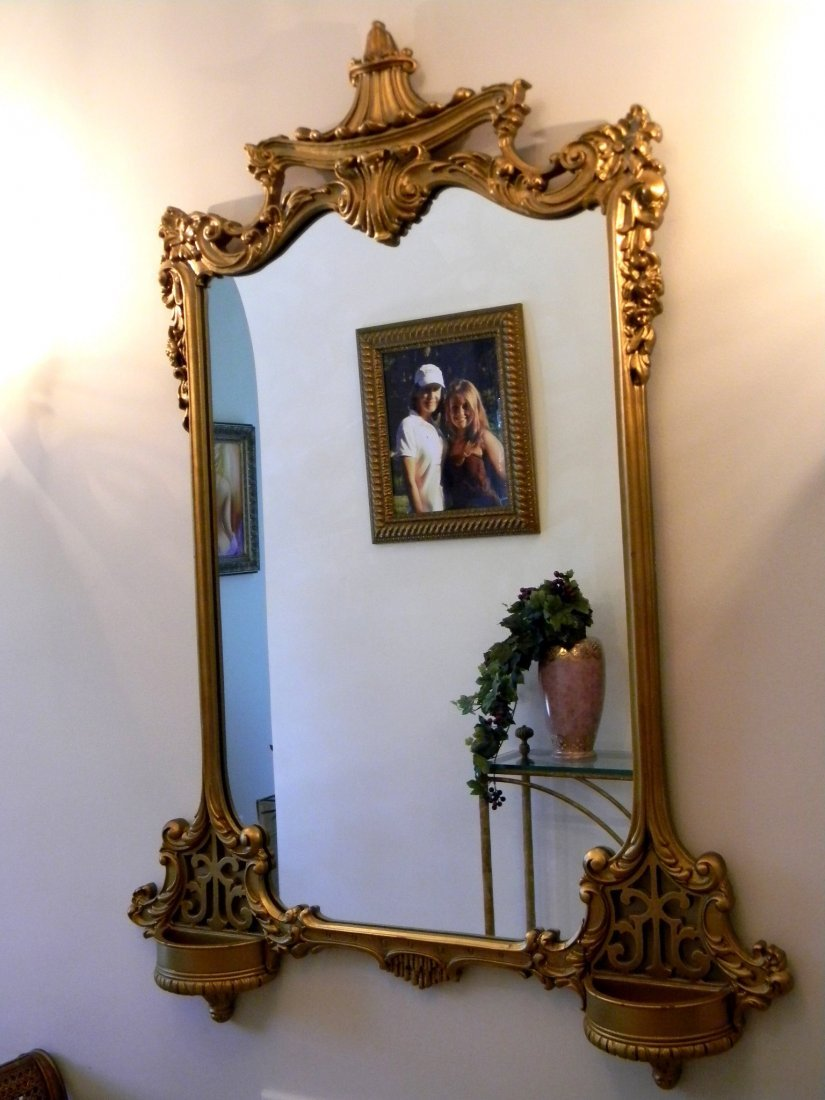 French style gold leaf painted mirror in foyer,