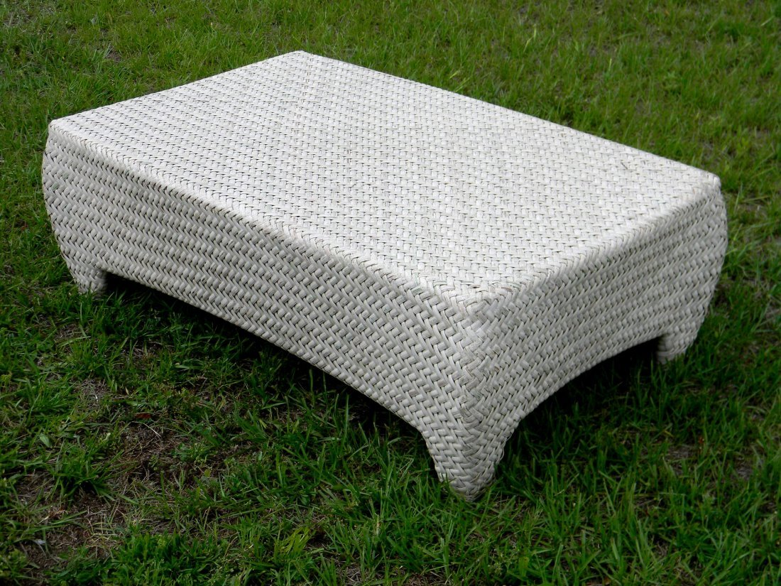 "Low Woven Rattan Coffee Table. 16.5"" h x 46"" w x 29"" d."