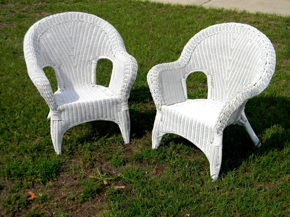 "Pair of Wicker Chairs. 31"" h 29"" w."