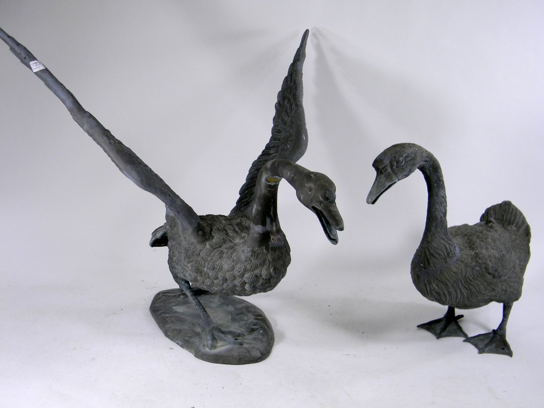 Pair of Large Patinated Metal Swans for use outdoors.