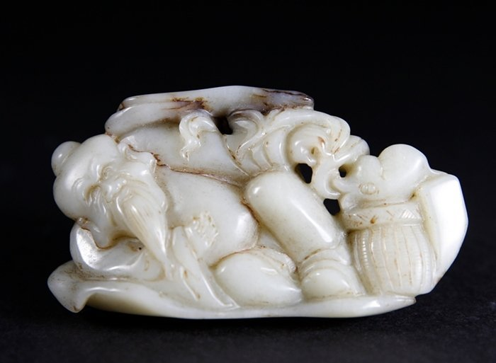 A Mottled Green And Pale Greenish-White Jadeite Figure