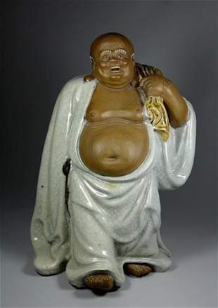 A RARE SHI WAN BUDAI PORCELAIN FIGURE