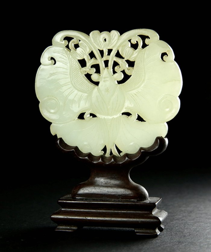 A QING GREEN AND WHITE JADE CARVED PIECE