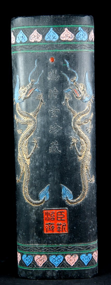A KANGXI MARK COLOUR INKSTONE WITH DRAGON PATTERN