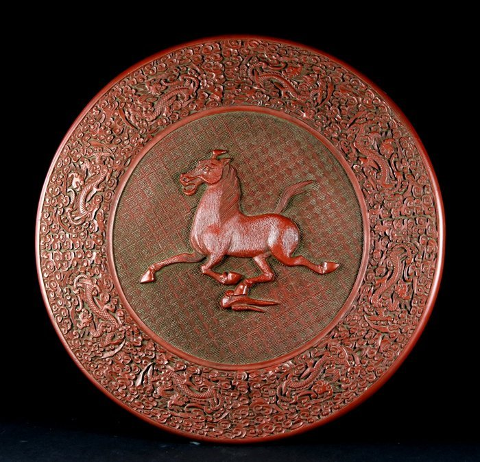 A QING KANGXI MARK 'RUNNING HORSE' CIRCULAR PLATE WITH