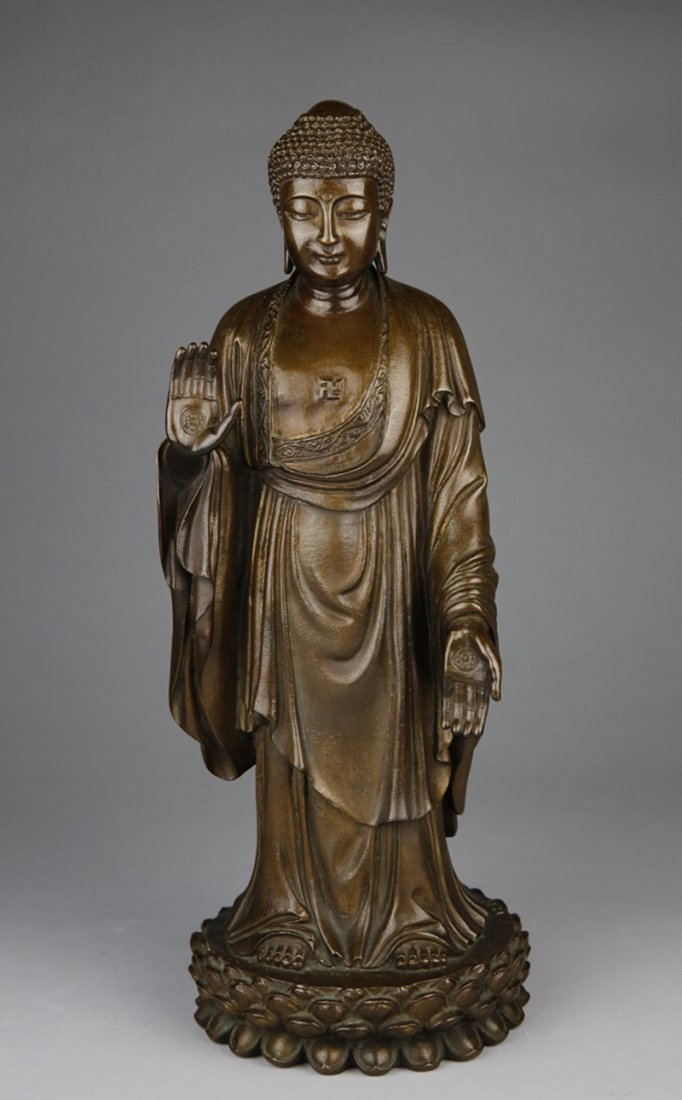 A LIMITED EDITION BRONZE STANDING FIGURE OF BUDDHA