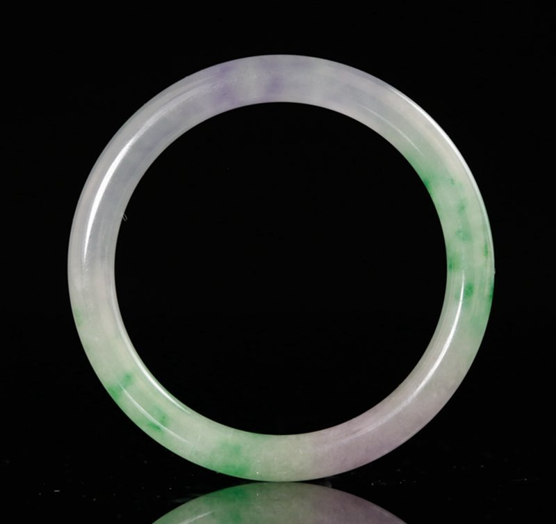 A SMALL JADEITE BANGLE