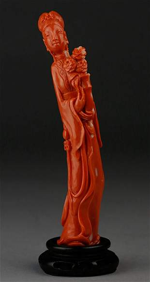 A CHINESE CARVED RED CORAL FIGURE OF A MAIDEN WITH VASE