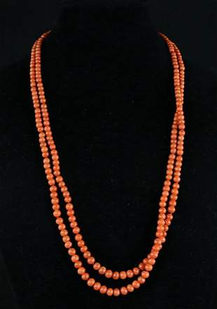 AN ANTIQUE TWO-STRAND CORAL NECKLACE