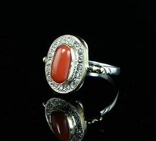 A RED CORAL AND STERLING SILVER RING