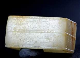 A WHITE JADE FITTING CARVED WITH MYTHICAL BEAST PATTERN
