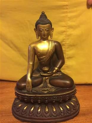 A BRONZE FIGURE OF SAKYAMUNI BUDDHA