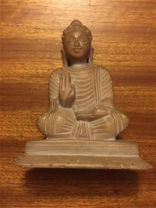 A MARBLE FIGURE OF SAKYAMUNI BUDDHA