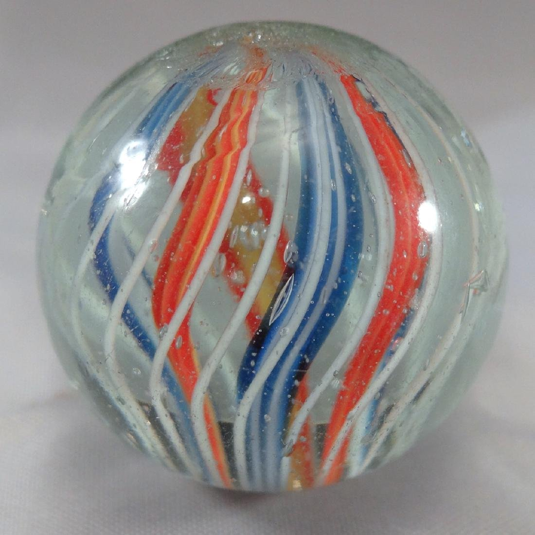 "Lot 56. SWIRL, Divided Core. 1-3/16"". 9.7 - 2"