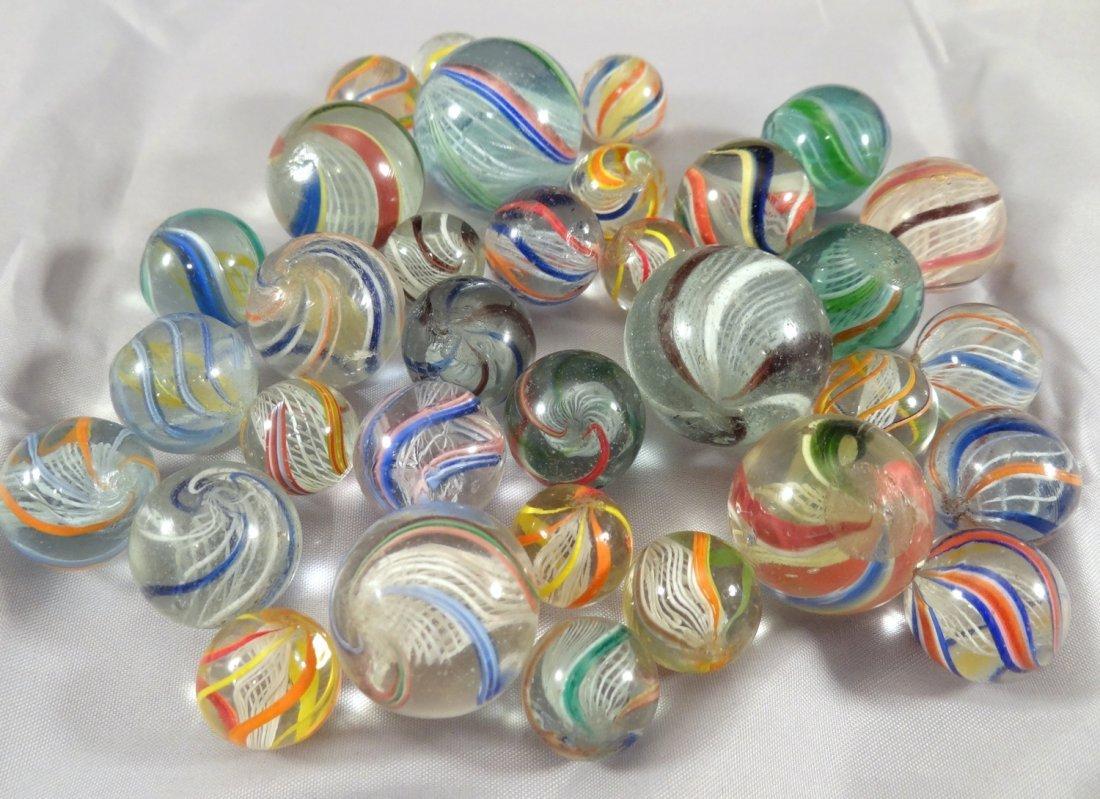 Lot 4. Thirty-four Latticinio Core Swirls