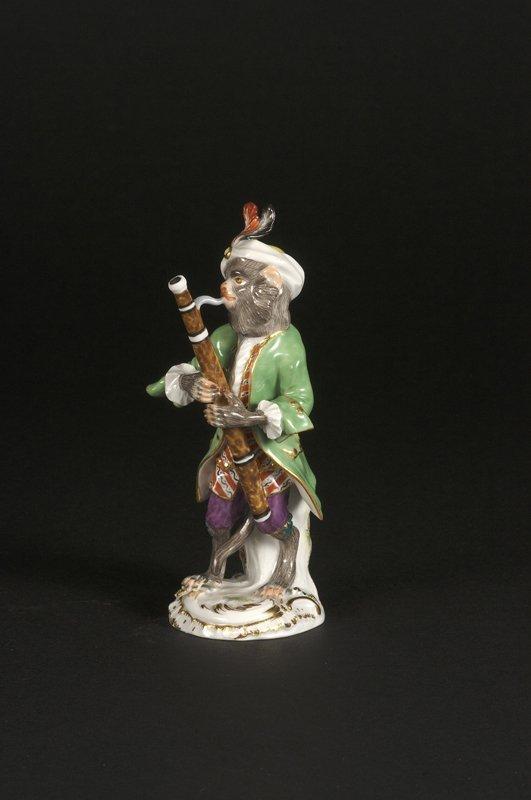 2: Affenkapelle Einzelfigur: Der Fagottspieler.