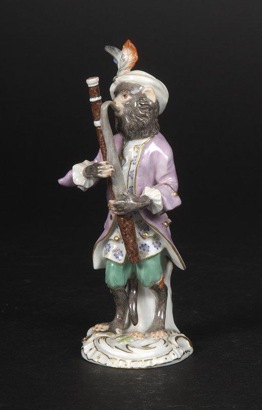 3: Affenkapelle Einzelfigur: Der Fagottspieler.