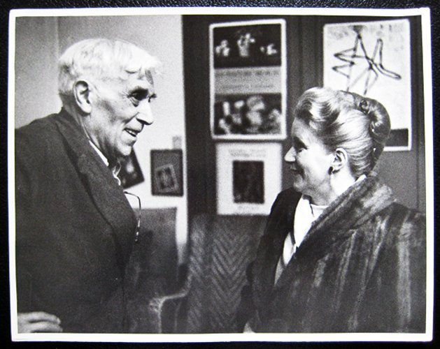 George Braque and a woman facing each other