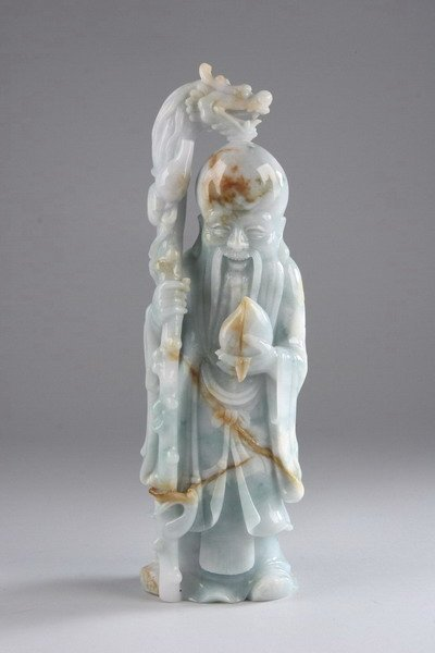 18: CHINESE WHITE AND CELADON JADE FIGURE OF IMMORTAL.