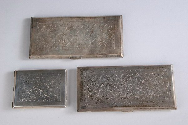 573: PAIR POLISH SILVER CIGARETTE CASES AND A COMPACT.