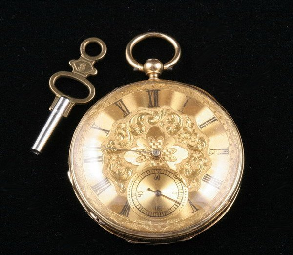 1099: LADY'S 18K YELLOW GOLD OPEN-FACE POCKETWATCH.