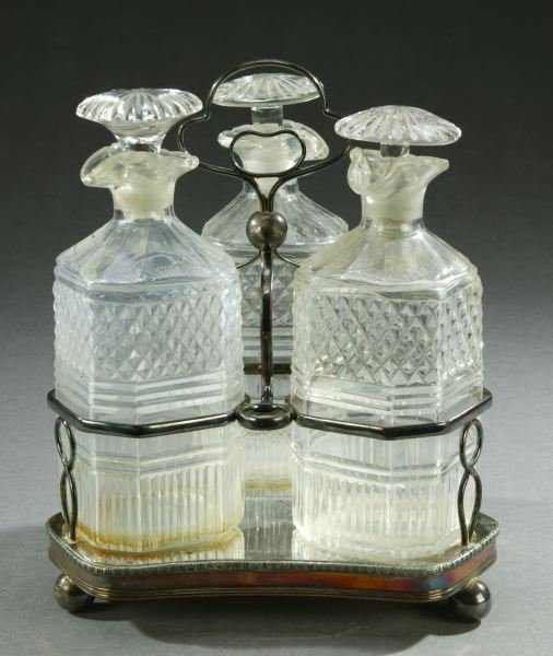9: A SHEFFIELD PLATE CRUET SET. - 7 3/4 in. high, the b