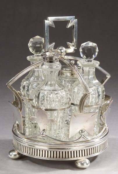 10: AN ENGLISH CRUET SET, - 9 in. high, the stand; 3 1/