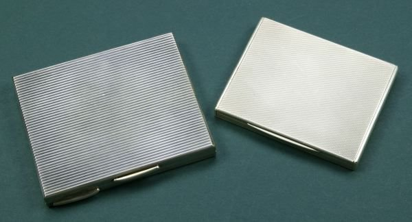 20: A GEORGE V SILVER CIGARETTE CASE AND A SILVER PLATE
