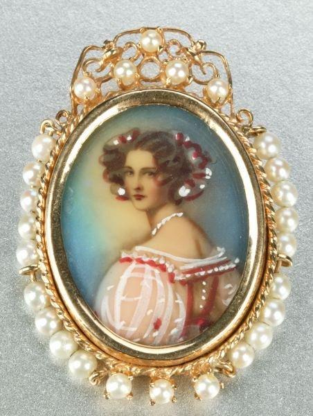 930: PORTRAIT OF A LADY BROOCH.