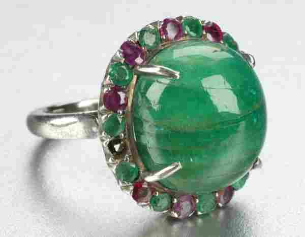 AN EMERALD AND RUBY RING.
