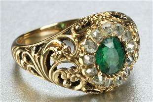 A YELLOW GOLD, EMERALD AND DIAMOND RING.