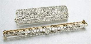 TWO ART DECO BAR BROOCHES.