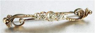 A VICTORIAN 14K YELLOW GOLD AND DIAMOND BROOCH.