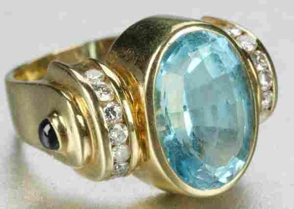 AN 18K YELLOW GOLD, BLUE TOPAZ, SAPPHIRE AND DIAMO