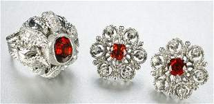 A GROUP OF WHITE GOLD AND GARNET JEWELRY.